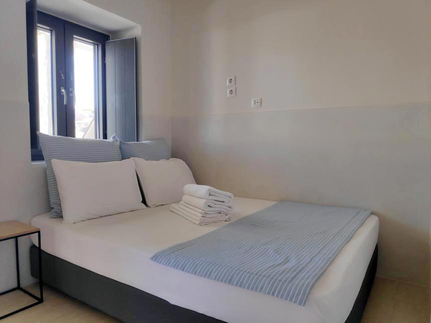 View of a ground floor double bedroom at Hotel Emily in Syros
