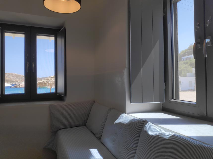 Cycladic minimal style: Partial view of the sofa bed of a triple bedroom at Hotel Emily in Syros.