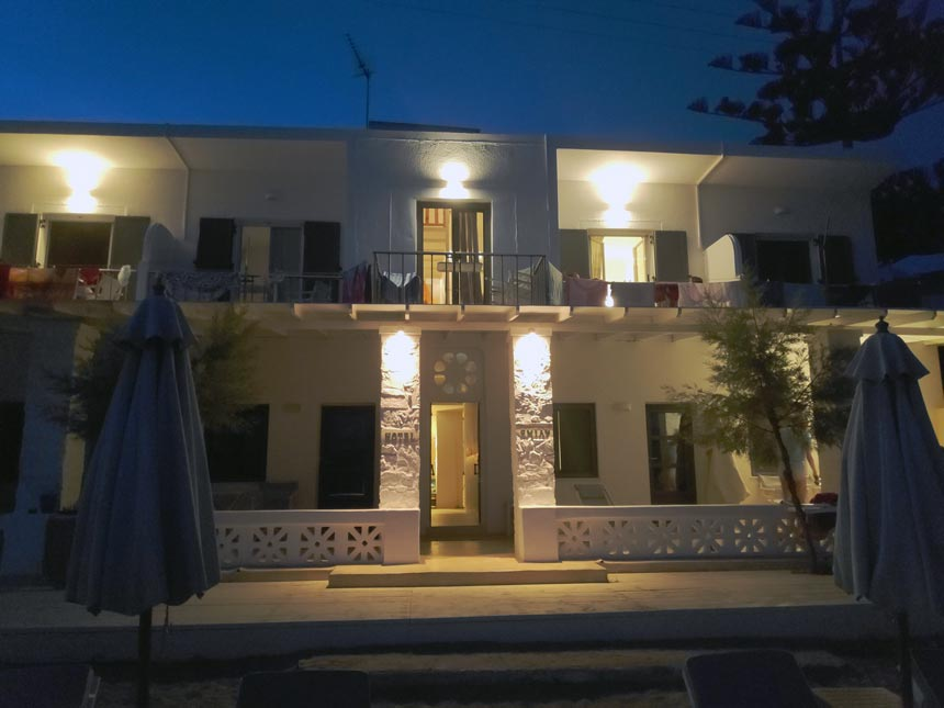 Cycladic minimal style: View of the external facade of Hotel Emily in Syros after sunset hours.