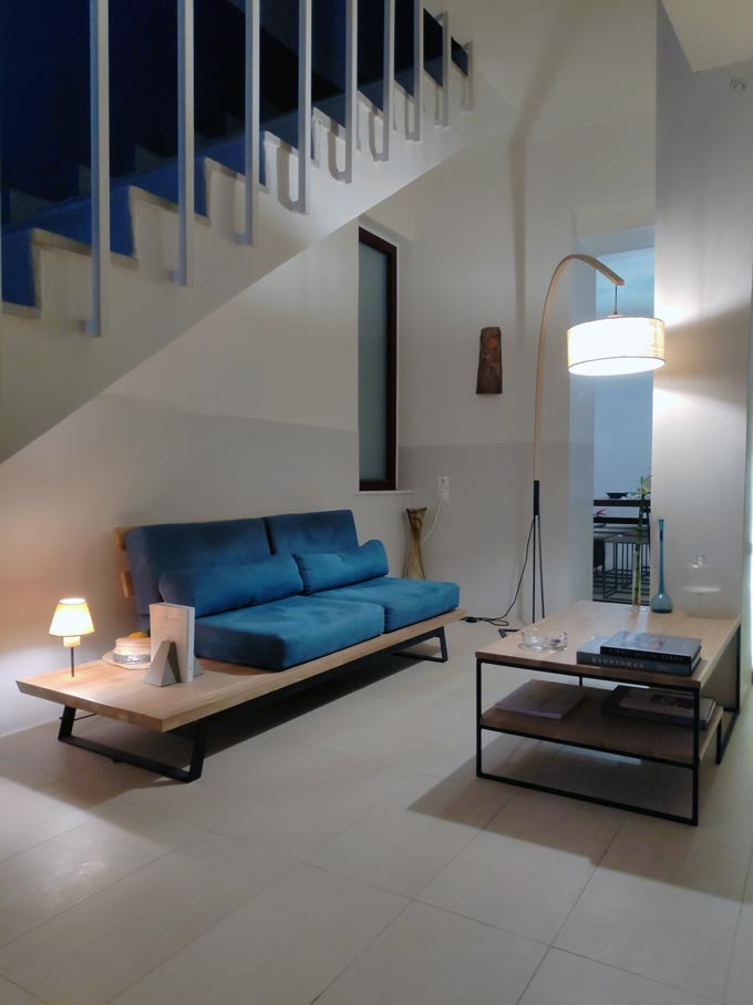 Another view of the tiny reception lobby with that blue custom made sofa and coffee table at Hotel Emily.