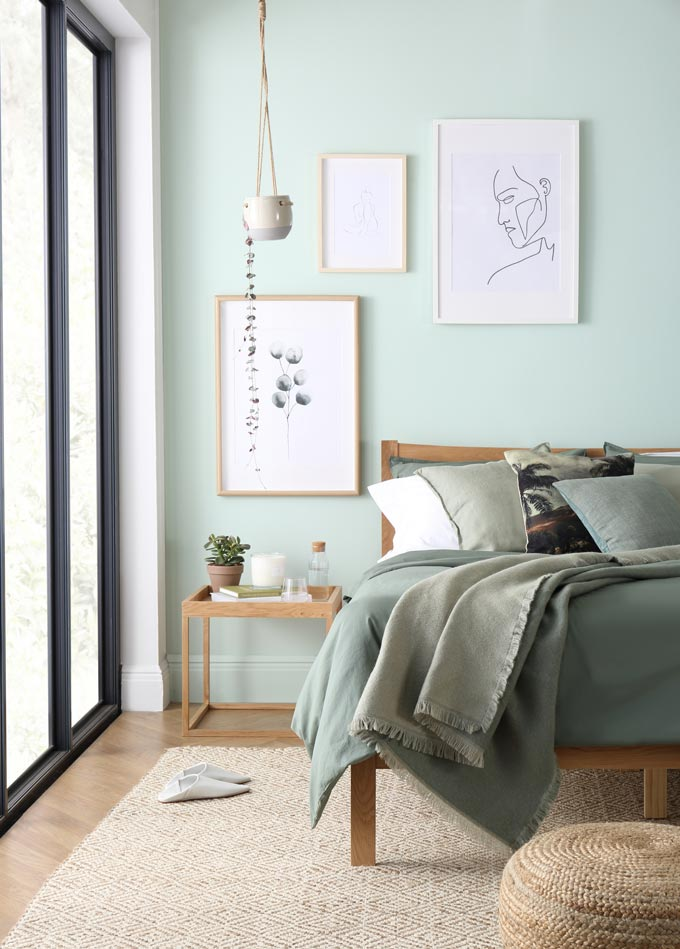 Tranquil dawn color of the year 2020: A stylish bedroom in a pastel green hue and an serene and tranquil vibe to it. Image by Furniture Choice Ltd.