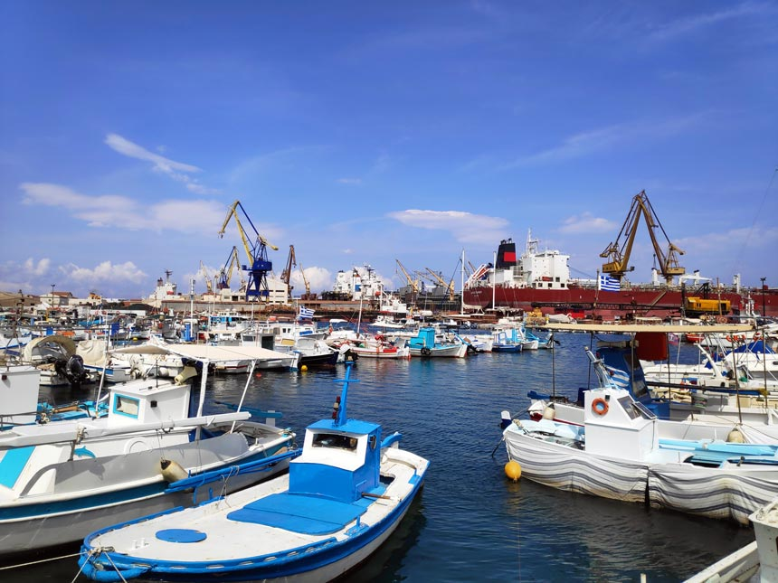 View of a marina in the foreground and the shipyard of Neorion in Syros in the background.