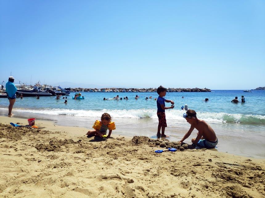 Kids playing on a beach.