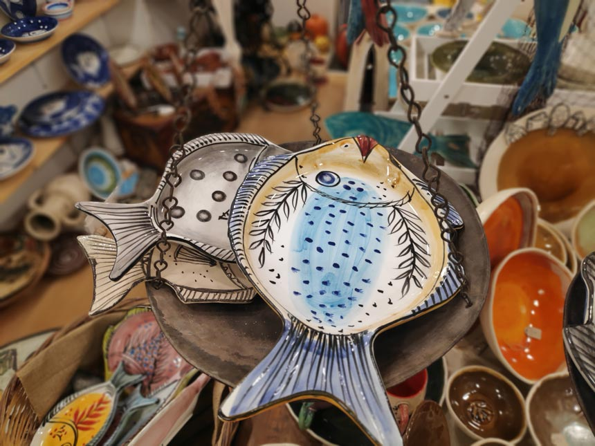 Detail of a ceramic food platter designed and hand painted as a fish from Maria Banou.