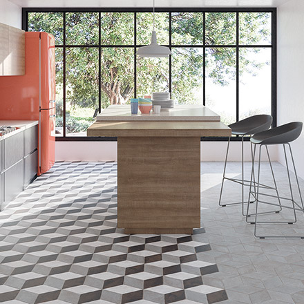 A stunning contemporary kitchen mainly because of the patterned diamond looking tile that changes colors right after the kitchen island and looks more neutral, more muted. Image: WOW Design.