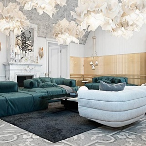 Partial view of a luxurious living room with a green modular sofa, white armchairs and lots of cloud like pendant lights..