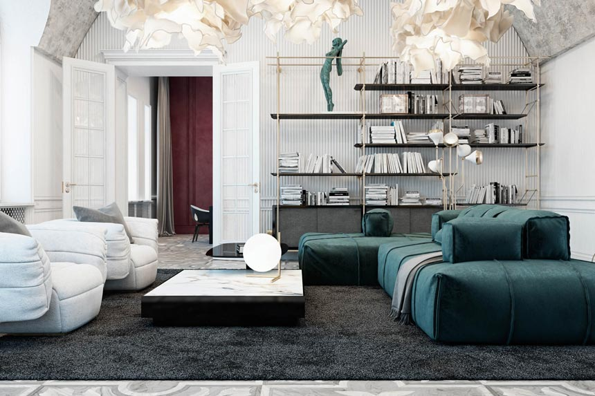 Partial view of a luxurious living room with a green modular sofa and white armchairs.