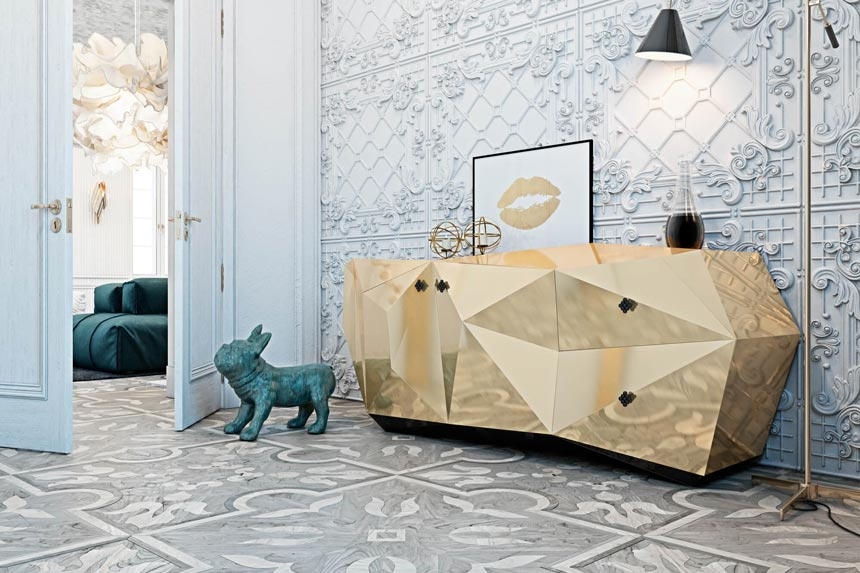 A stunning sideboard shaped like a gold diamond against a highly decorated accent wall from a design project by Diff studio.