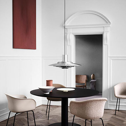 P376 pendant light hanging over a side table with decor and next to a window. Image by Nest.