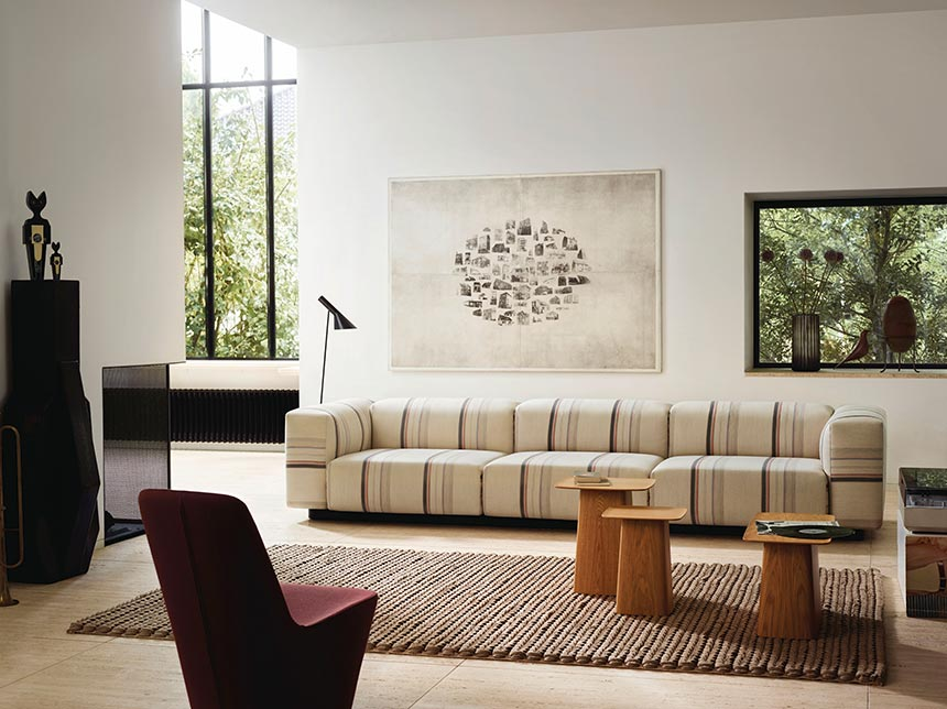 A neutral contemporary living room with a print pattern sofa. Image via Nest.co.uk.