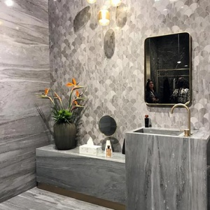 A marble bathroom installation from Atlas Concorde at the Cersaie 2019. Love the accent wall with the fishscale tile accent.