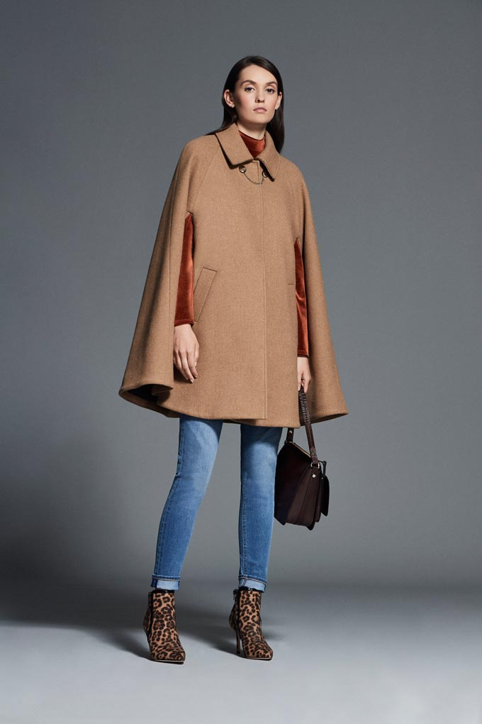 Winter outfits lookbook: A camel cape coat paired with skinny jeans and leopard print booties. Image via Debenhams.