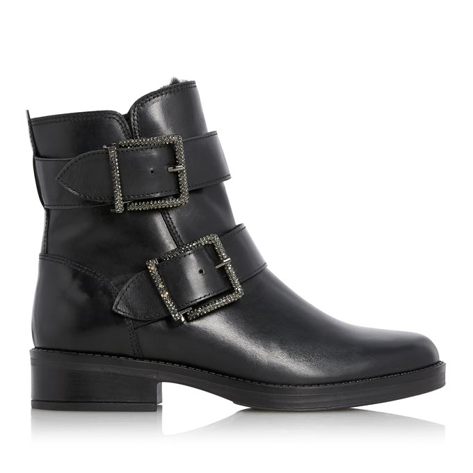 A black ankle boot with two buckles. Image via Dune.