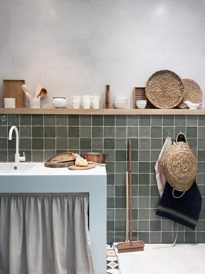 A kitchen installation by Roca at Cersaie 2019 with green Zellige tiles.