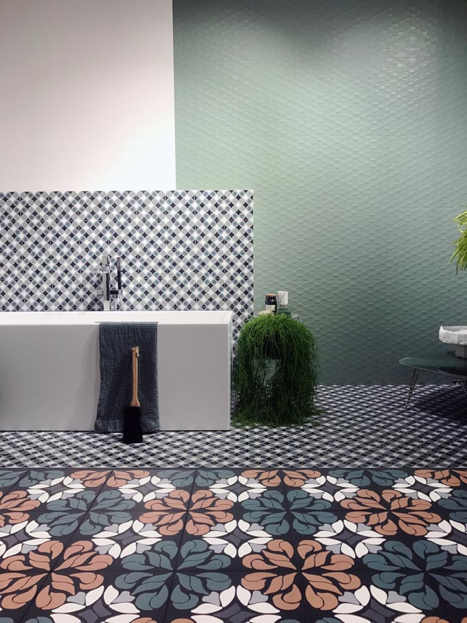 View of a tile exhibition booth at Cersaie 2019 from Santagostino with lots of patterned tiles.