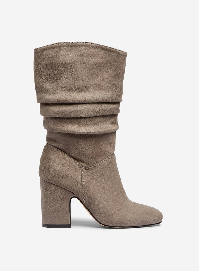A beige suede slouch boot. Image via Dorothy Perkins.