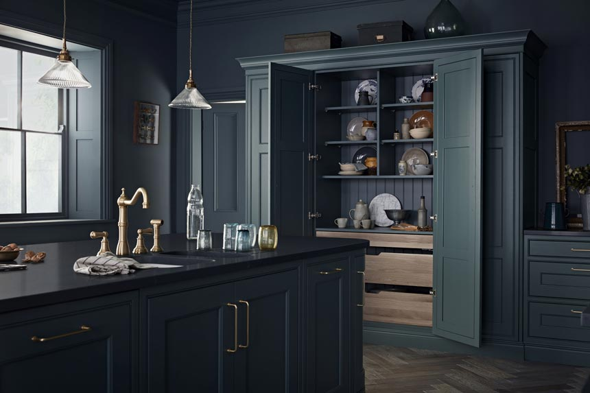 A moody dark blue green kitchen that has gotten my heart skipping. Image via Kitchenmakers.