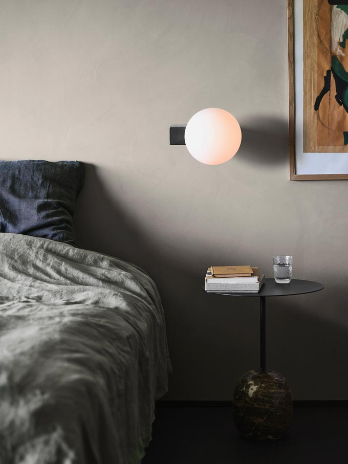 I love this wall light over that side table by the bed in this light olive green bedroom. Image via Nest.co.uk.
