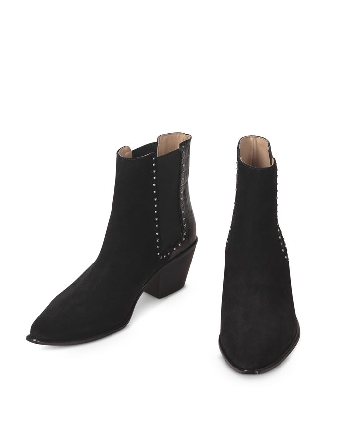 A pair of Western inspired black ankle boots. Image via Oliver Bonas.