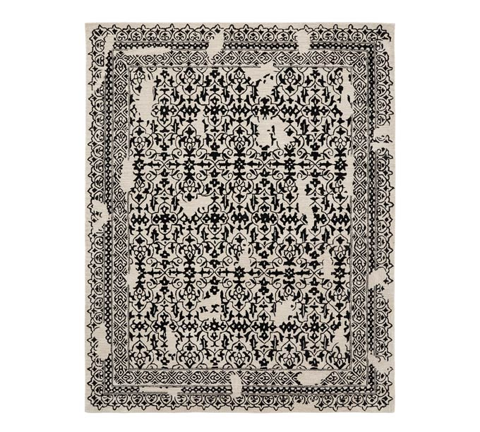 A black patterned rug with a boho flair. Image via Pottery Barn.