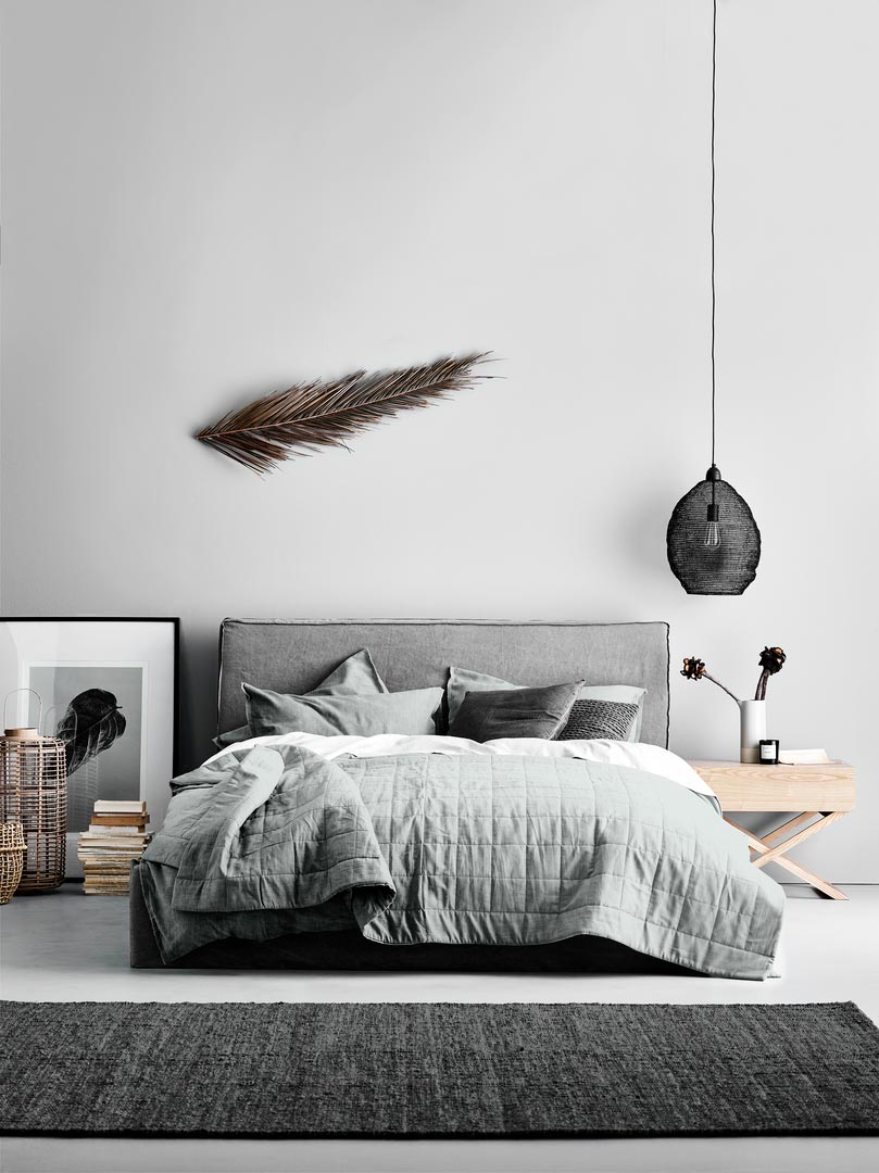A grey Scandi-boho chic bedroom with a relaxed vibe. Notice how the bedding helps create that look Image by Aura Home.