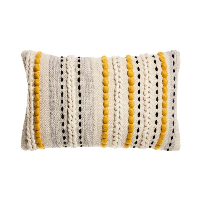A cut image of a boho inspired decorative cushion. Image by Adairs.