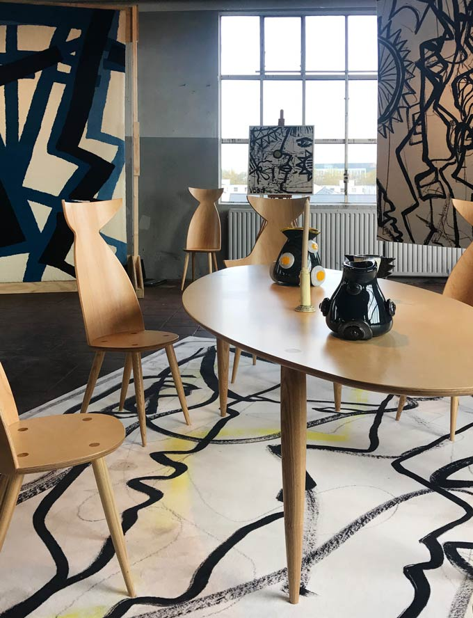 A dining table setting with rugs designed by Victor de Bie at the 2019 Dutch Design Week.
