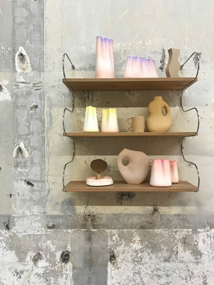 Decor on shelves. Detail view from Elle Decoration Fluid Forces installation during the 2019 Dutch Design Week.