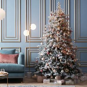 A beautifully styled Christmas tree with blush pink baubles. Image via John Lewis.