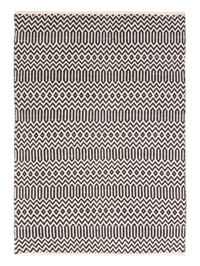 A black pattern boho inspired rug. Image by Very.co.uk.