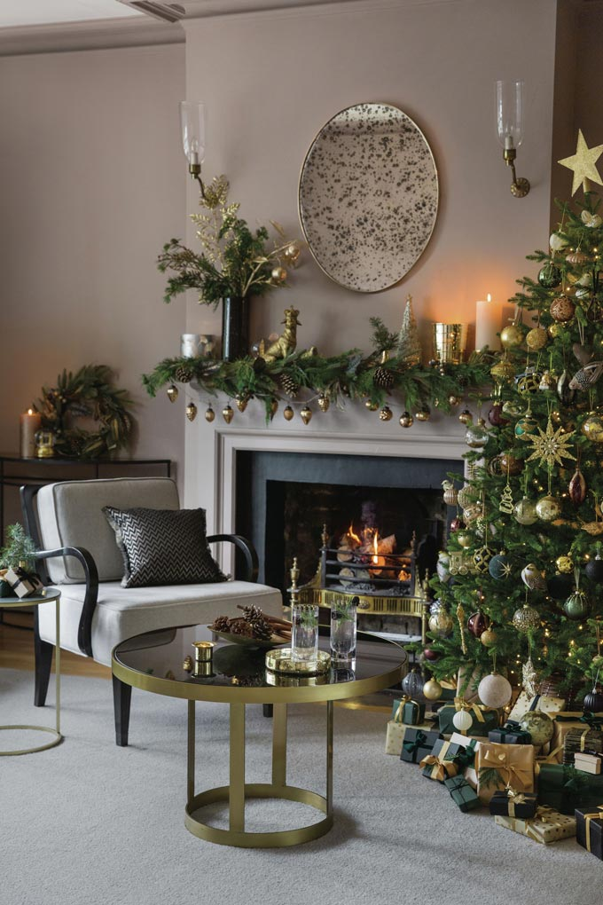 How timeless is the all gold decoration on a green Christmas tree? Image via Amara.