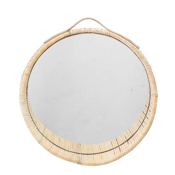 A cut image of a round mirror with a rattan frame. Image via Cult Furniture.