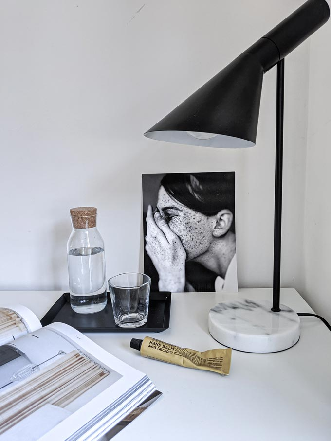 A small table lamp with a white marble base on a white desk. Image via Cult Furniture. Marble decor ideas.