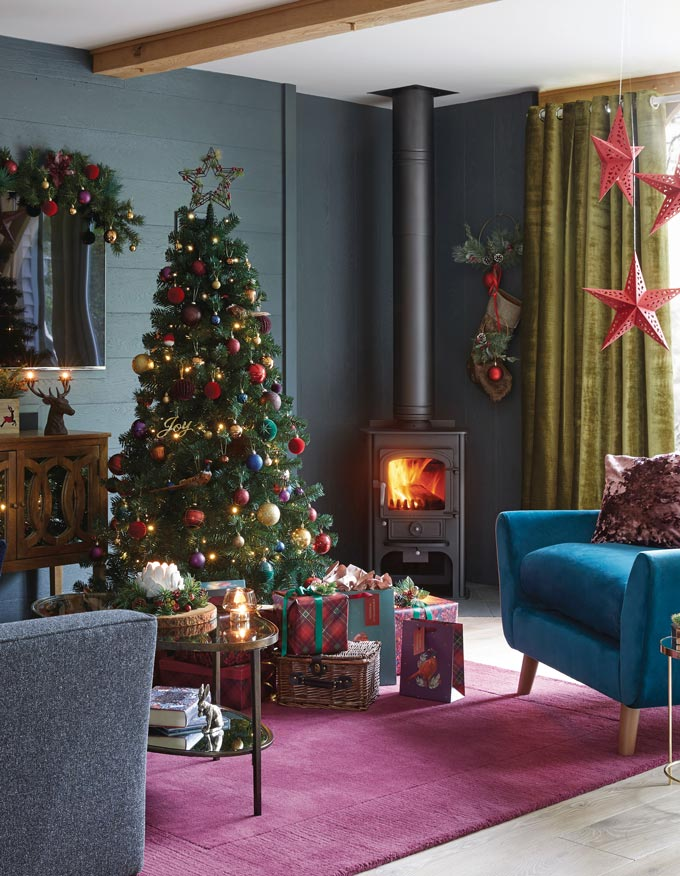 Gold and red decorations for a green Christmas tree. Traditional yet timeless. Image via Dunelm.