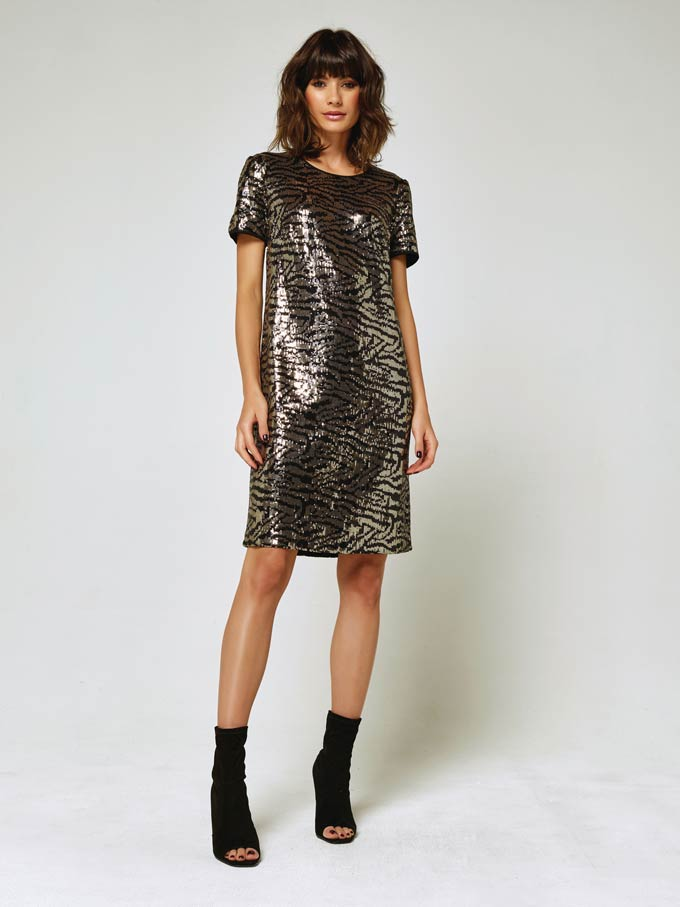 A short sleeve knee high dress with sequins in a zebra inspired pattern - perfect for the holidays. Image via M&Co.