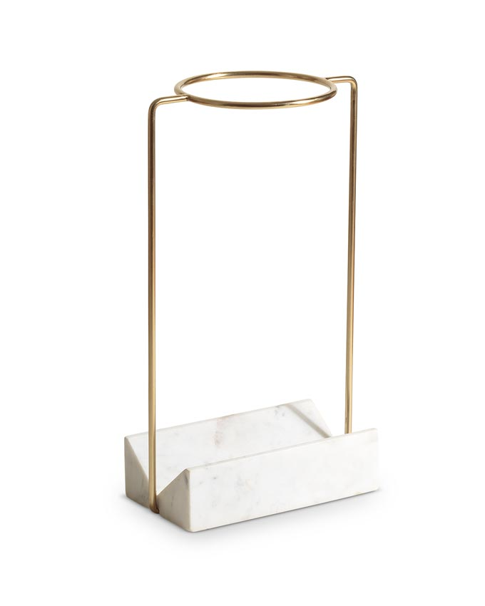 An umbrella stand with a white marble base from Oliver Bonas. Marble decor ideas.