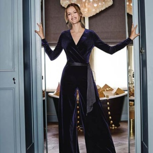 A dark blue velvet jumpsuit ideal for a night out! Image via Pure Collection.