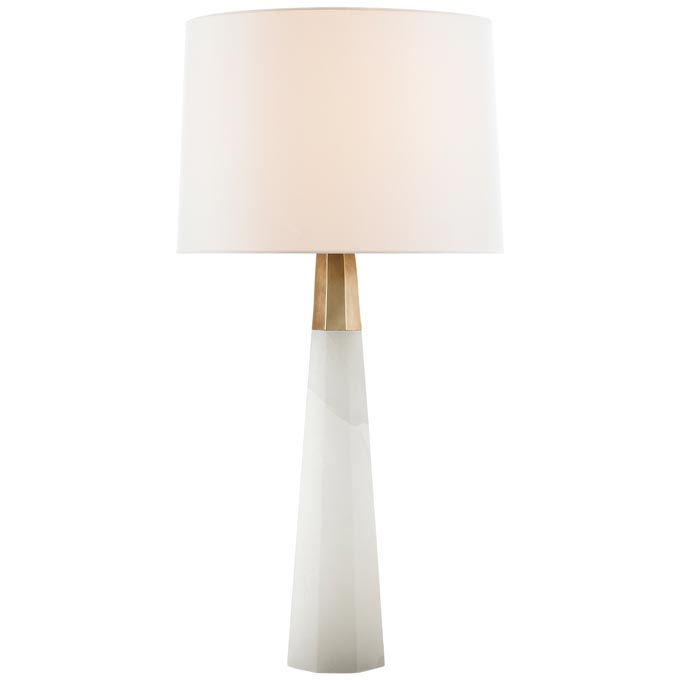 The Olsen table lamp in alabaster and hand-rubbed antique brass with linen shade by AERIN for Visual Comfort & Co.Image via Stockist: The Montauk Lighting Co.