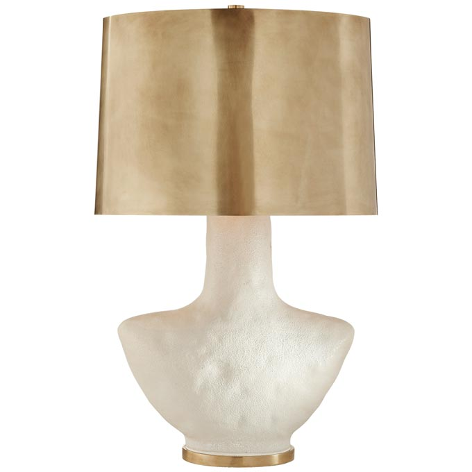 A gorgeous table lamp that goes by the name Armato, with a porous white ceramic with oval antique-burnished brass shade by Kelly Wearstler. Image via The Montauk Lighting Co.