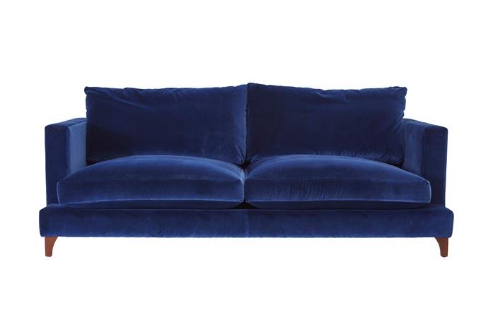 A blue velvet sofa. Image: Darlings of Chelsea.
