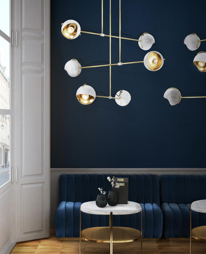 A naval blue inspired room with white accents and brass details. Image by Essential Home.