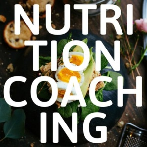 An egg sandwich in the background and the words nutrition coaching standing out on an overlay.
