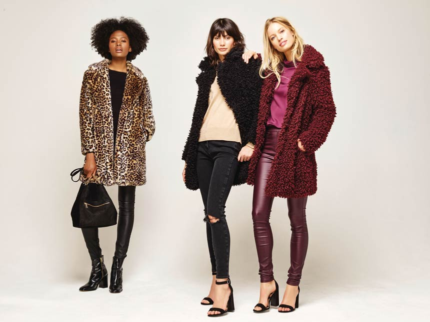 Three women in winter outfits featuring a leopard coat and two teddy coats. Image via M&Co.