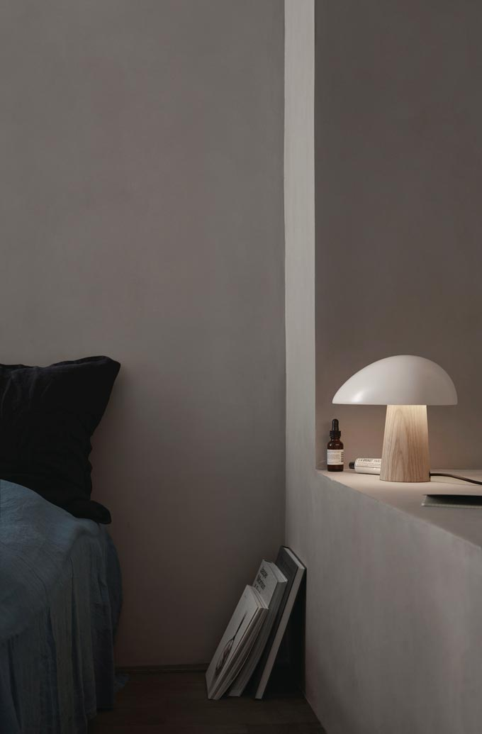 The Fritz Hansen night owl table lamp resting on a nearby shelf in a bedroom. Image via Nest.co.uk.