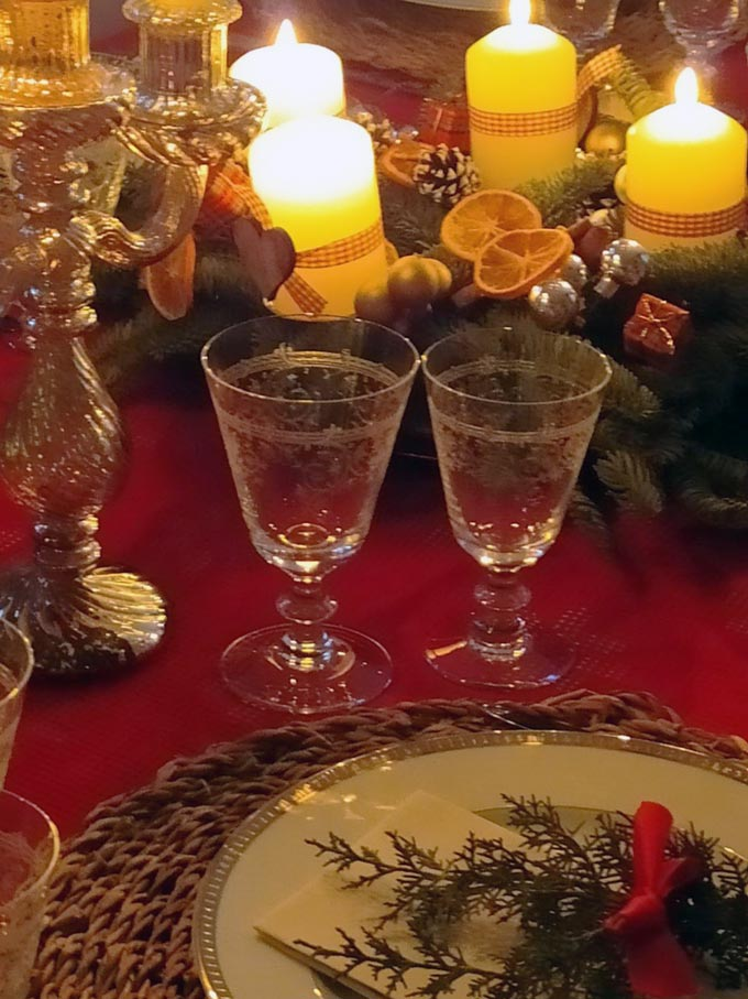 Looking closer at a Christmas table setting with an Advent wreath as the centerpiece.