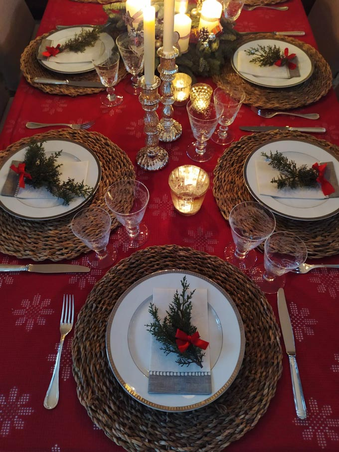 Looking down at a beautiful Christmas table setting.