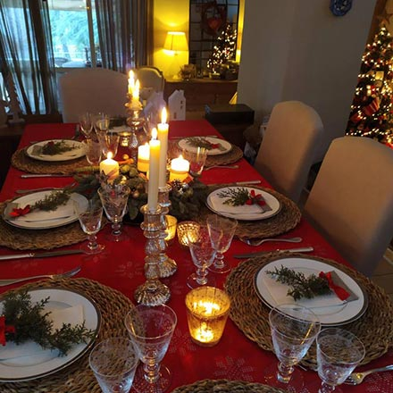 View of a beautifully styled table setting for Christmas.