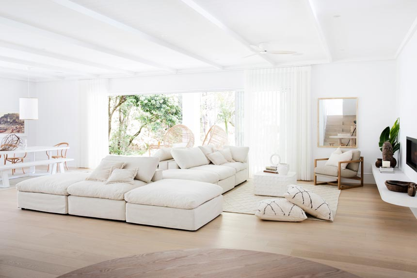 House Tour: Another view of a super-stylish all white interior. The seating area is shown here. Photo: Three Birds Renovations/Raja Homewares.