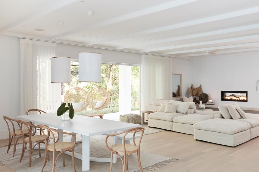 House Tour: Such a stylish all white open space interior. The dining and sitting area shown here. Photo: Three Birds Renovations/Raja Homewares.