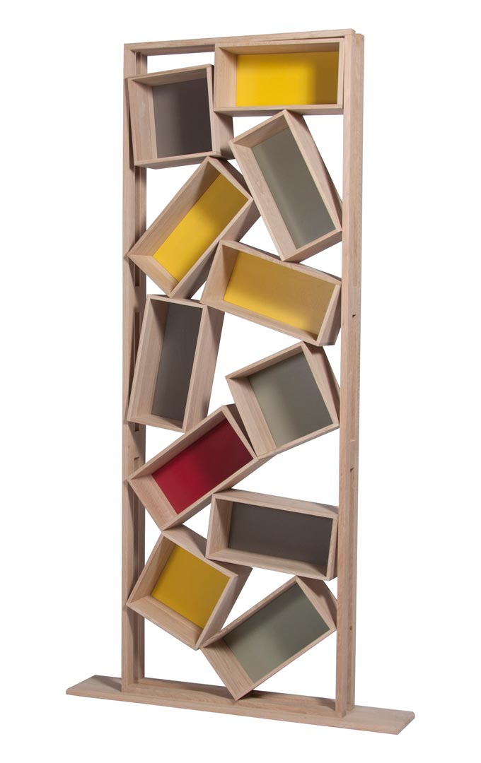 A statement bookcase without the typical shelves, but various boxes in a disorderly array. Image: HolzDesignPur.